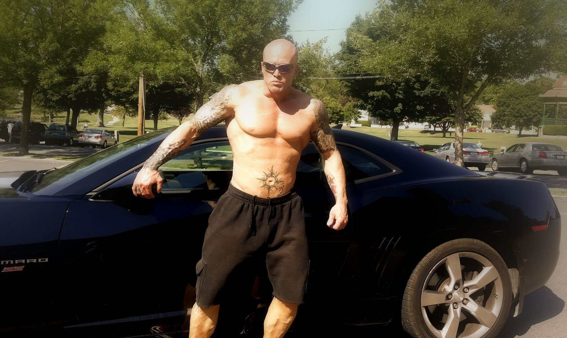 Tattooed Physique Model John Quinlan with Camaro 14'