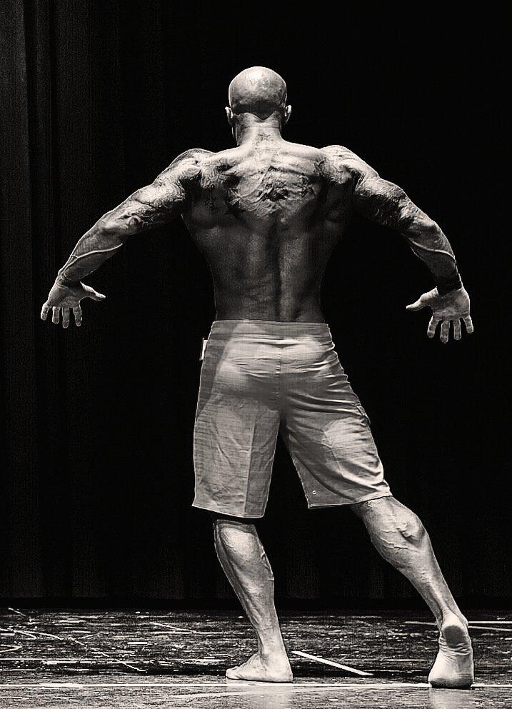 John Joseph Quinlan 2015 NPC Vermont Bodybuilding Championships Men's Physique on Stage B&W Photo by Chris Keeley #JohnQuinlan