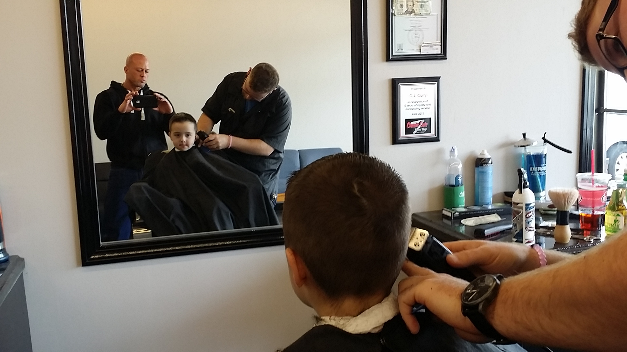 "John Quinlan with Son Cole @ Classic Cuts Barbershop Wakefield. MA. with Barber CJ Curry via Halloween 2015 ""Nice job CJ, my son thinks your the greatest barber. I appreciated you and your staff being so great to my children"" God Bless, - John Quinlan 11/2/2015 #JohnQuinlan"